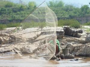 Pecheur dans le Mekong